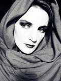 BW Woman Wearing A Scarf. A classic black and white female portrait. Woman is wrapped in a scarf royalty free stock image