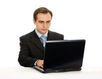 Bworking su un computer portatile. Isolato su bianco. Fotografie Stock Libere da Diritti