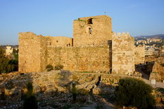 Byblos Crusaders Fort. Crusader Fort of Byblos, on the Mediterranean Coast, Lebanon. Built by the Crusaders in the 12th century. In the foreground Phoenician and Royalty Free Stock Photo