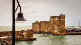Byblos Fishing Port Lebanon. Ancient, historic and decaying stone fishing port of Byblos Lebanon on an overcast day royalty free stock image