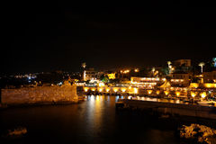 Byblos at night (Lebanon). The city of Byblos (Jbeil) with its landmark archeological sites including the sea fortress seen here guarding the ancient port at Royalty Free Stock Image