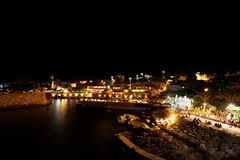 Byblos at Night (Lebanon). Nighttime in the Byblos Summertime Season: tourists fill the cafes and restaurants of the landmark ancient port and town (Lebanon Stock Photo