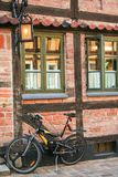 Bycicle on a brick  red wall Stock Photo