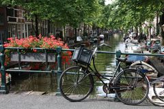 Bycicle on bridge in Amsterdam. Bycicle on bridge over canal in Amsterdam Stock Photo