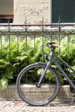 Bycicle in front of metal fence. Of a Berlin city house Stock Image