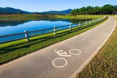 Bike Lane in Park. Bycicle lane with icon in suburb park Royalty Free Stock Image