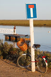 Bycicle leaning on a dead end sign Royalty Free Stock Photos