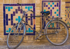 Bycicle near the wall with traditional floral mosaic decoration, Royalty Free Stock Image