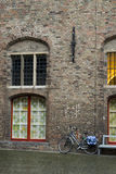 Bycicle and old building Stock Photo