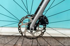 Bycicle racing brake system. With ished rotor and black caliper stock photography