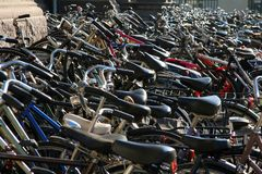 Hundreds of bikes on sidewalk stock photography