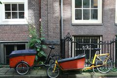 Bycicles in front of brick house. Bycicles in front of Amsterdam brick house Royalty Free Stock Image