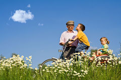 Bycycle ride with grandpa in the spring Stock Images