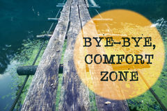 Bye-bye comfort. Bye-bye, comfort zone message written over weathered wooden rope bridge royalty free stock image