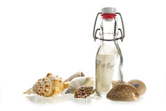 Bye bye message in a bottle made of glass between some sea shell. Bye bye  message in a bottle made of glass between some sea shells isolated on a white Stock Photo