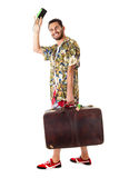 Bye-bye. A young, attractive male in a colorful outfit ready to travel as a stereotype tourist Stock Photo
