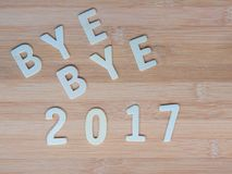 Bye bye 2017. Wooden letters of bye bye 2017 on the table Stock Photography