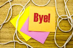 Bye - word on yellow sticky note in wooden background. Bussines concept. Royalty Free Stock Photography