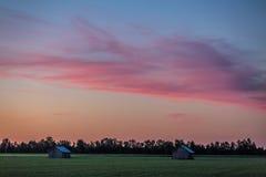 Bygd efter solnedgång Royaltyfria Bilder