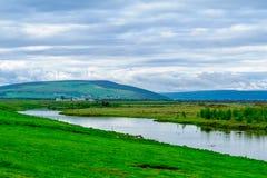 Bygd landskap i nordostliga Island arkivbild