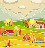 Bygdplats med hus och trädet i höst Arkivfoton