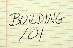 Byggande av 101 på ett gult lagligt block Royaltyfria Foton