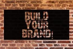 Byggande för textteckenvisning ditt märke Begreppsmässigt foto att skapa din egen logosloganmodell som annonserar E som marknadsf royaltyfri bild