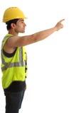 byggmästarekonstruktionsfinger som pekar arbetaren Arkivfoton