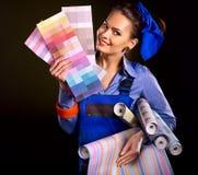 Byggmästarekvinna med tapeten Arkivbilder