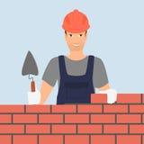 Byggmästaremannen bygger en tegelstenvägg Arkivfoton