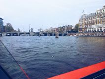 Byggnader och broar av Amsterdam Royaltyfri Foto