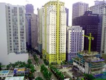 Byggnader och skyskrapor i det Ortigas komplexet i den Pasig staden, Manila, Filippinerna Arkivfoton