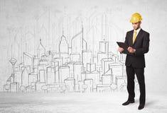 Byggnadsarbetare med cityscapebakgrund Arkivfoton
