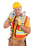 Byggnadsarbetare på mobiltelefonen som isoleras på vit Royaltyfri Foto