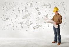 Byggnadsarbetare som hyvlar med hand drog hjälpmedelsymboler arkivbilder