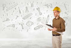 Byggnadsarbetare som hyvlar med hand drog hjälpmedelsymboler royaltyfri fotografi