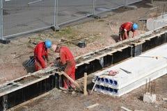 byggnadsarbetarear Arkivfoto