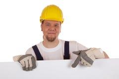 Byggnadsarbetarevisning på ett tomt tecken royaltyfri foto