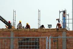 byggnadsbyggnadsarbetarear Fotografering för Bildbyråer