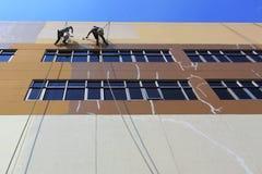 byggnadsmanmålning Arkivbild