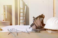 Byggnadsutrustning, maskinvara och byggnadsplan Arkivfoton
