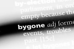 Bygone. Word in a dictionary.  concept royalty free stock photography