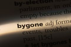 Bygone. Word in a dictionary.  concept royalty free stock photo