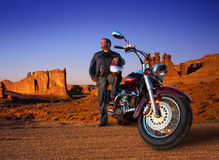 Biker. With helmet over the mountains royalty free stock photos