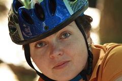 Byker. A beautiful gir with blue helmet go by bicycle Stock Image