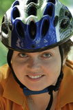 Byker. A beautiful gir with blue helmet go by bicycle Royalty Free Stock Photography