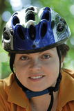 Byker. A beautiful gir with blue helmet go by bicycle Stock Photo