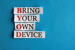 BYOD. Acronym  in business concept, words on cut paper hard light Stock Photography