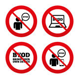 BYOD signs. Human with notebook and smartphone Royalty Free Stock Photo