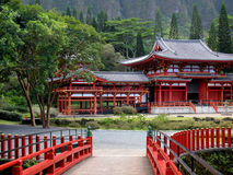 Byodo-In Buddhist Temple. Located on Oahu's Windward side, sits amidst lush greenery and against a beautiful misty mountain backdrop Stock Image